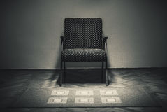 Vintage Armchair and Carpet Stock Images