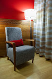 Vintage armchair and lamp Royalty Free Stock Image