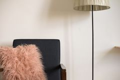 Armchair and lamp in minimal interior Stock Photography
