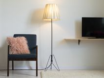 Armchair and lamp in minimal interior. TV Royalty Free Stock Photo
