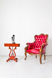 Vintage armchair and telephone Royalty Free Stock Photos