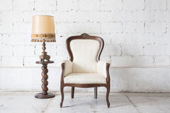 Vintage armchair on white wall. Stock Images