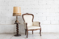 Vintage armchair on white wall. Stock Photography
