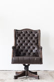 Vintage armchair on white wall. Stock Photos
