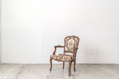 Vintage armchair on white wall. Brown vintage armchair on white wall Stock Image