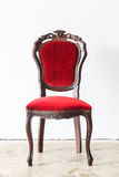 Vintage armchair on white wall. Royalty Free Stock Photography