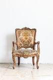 Vintage armchair on white wall. stock image