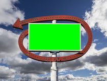 Vintage Arrow Sign with Chroma Green Insert and Clouds. Vintage arrow sign with chroma key green insert and clouds Royalty Free Stock Images