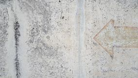 Vintage  arrow sign on mortar floor. Use for background and texture Royalty Free Stock Photography