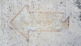 Vintage  arrow sign on mortar floor. Use for background and texture Royalty Free Stock Photo