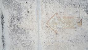 Vintage  arrow sign on mortar floor. Use for background and texture Stock Photo