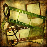 Vintage art. Old artistic  background with film strips Royalty Free Stock Image