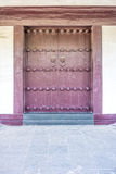 The vintage art of Chinese temple wooden door Stock Photos