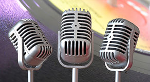 Vintage art deco mic trio Stock Photos