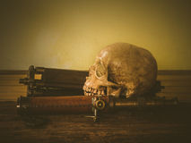 Vintage art skull. Still life with human skull and vintage binocular on abstract background stock photos