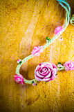 Vintage of artificial flowers rose on the old paper stripes. Royalty Free Stock Photography