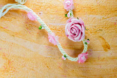 Vintage of artificial flowers rose on the old paper stripes. Royalty Free Stock Photos