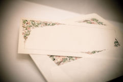 Vintage artistic edit of a decorated letter card with and envelo Stock Photo
