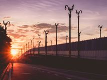 vintage asia architecture lamp post on asia beautiful contry road with sunrise and man biking background from thailand royalty free stock photo
