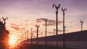 Vintage asia architecture on lamp post on asia beautiful contry. Road with  sunrise background from thailand Royalty Free Stock Photo