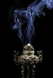 Vintage asian style iron vase on a black background with reflection and nice smoke Stock Photography