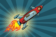 Vintage astronaut in a small spaceship in space. Pop art retro comic book vector illustration. Science and flights to other planets Stock Image
