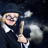 Star gazing astronomer with vintage telescope Royalty Free Stock Images