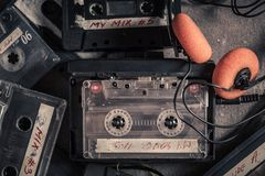 Vintage audio cassette with headphones and red walkman stock photography