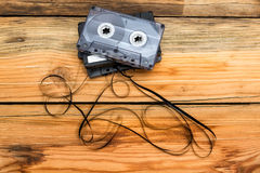 Vintage audio cassette with loose tape shaping two hearts on a w Stock Photos