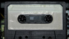 Vintage audio cassette tape with a blank label. Vintage audio cassette tape with a blank white label stock video footage