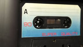 Audio cassette tape with a blank white label stock video footage