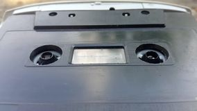 The Vintage Black Audio Cassette in the Tape Recorder Rotates stock video footage