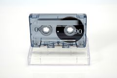 Vintage audio compact cassette. Cassette on a white background, front view with box royalty free stock photo