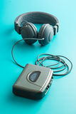 The vintage audio player and headphones. Royalty Free Stock Photography