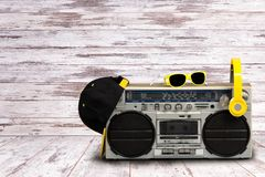 Vintage audio player with headphones.fashionable cap and sunglasses.Vintage style .The concept of the music Hip hop style. royalty free stock photography