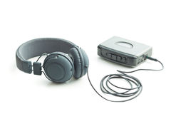 The vintage audio player and headphones. Stock Image