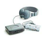 The vintage audio player and headphones. Stock Photo