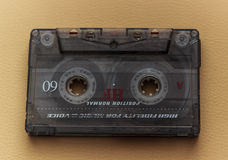Vintage audio tape cassete. Picture of a retro, dusty, used, old cassette tape from 70s 80s 90s Stock Photo