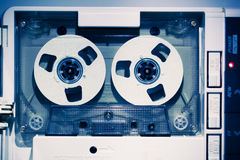 Vintage audio tape compact cassette. Blue tone royalty free stock photo