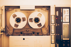 Vintage audio tape compact cassette. Sepia tone with artistic film noise stock photo