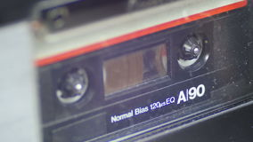 Vintage Audio Tape. Audio Tape. Vintage tape recorder plays the tape inserted therein. Macro static camera view of vintage audio cassette tape with a blank white stock video footage