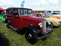 Red vintage Austin car showing outdoor. Vintage Austin car show outdoor at Northumberland Wings & Wheels festival at Eshott Airfield north of Morpeth, England royalty free stock images