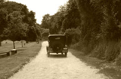 Vintage Auto. Photo of a VIntage Auto on a Dirt Road - Sepia Tone stock images