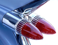 Vintage Auto Fin. Blue fin and red taillights of vintage American luxury automobile Royalty Free Stock Photo