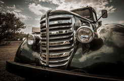 Vintage auto. Front grill and headlights of vintage automobile with filter applied Stock Photo
