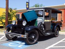 Vintage auto in handicapped parking space