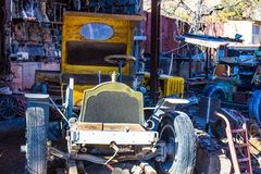 Vintage Auto Scrapped In Salvage Yard. Vintage Automobile Along With Other Material Scrapped In Salvage Yard Stock Images