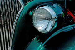 Vintage Automobile. Grille, headlamp, and green paint Royalty Free Stock Images