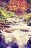 Vintage autumn landscape with waterfall Royalty Free Stock Image
