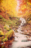 Vintage autumn landscape with waterfall Stock Photography